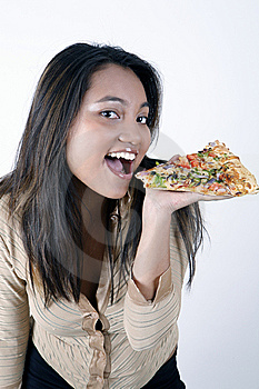 Girl Eating Pizza Slice Royalty Free Stock Photography - Image: 9303277