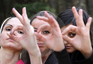 Girls Looking Through Their Crossed  Fingers Stock Image - Image: 9304761