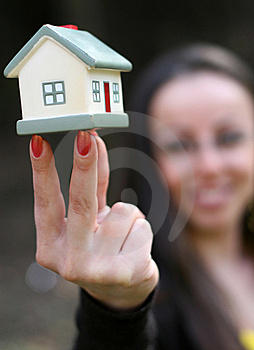 Woman Offering A House Stock Image - Image: 9304831