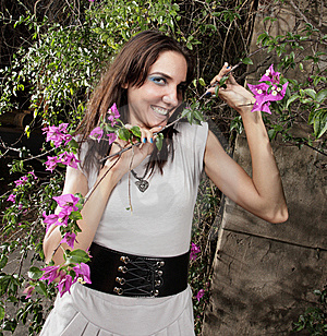 Woman Smiling In A Garden Royalty Free Stock Photo - Image: 9366895