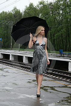 Girl Walking With An Umbrella Royalty Free Stock Image - Image: 9373676