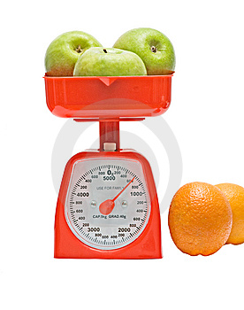 Kitchen Scale Weighting Apples Royalty Free Stock Images - Image: 9378579