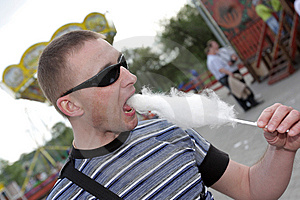 Man Eats Candy Floss Stock Image - Image: 9380061