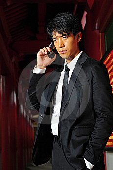 Asian Man With Cell Phone Royalty Free Stock Photo - Image: 9409255