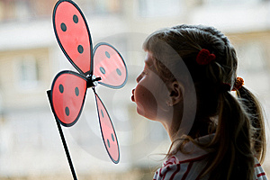 A Little Girl With A Windmill Toy Royalty Free Stock Images - Image: 9425859