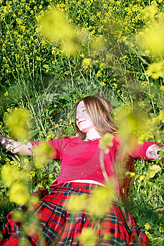 Girl In Green Grass And Yellow Flowers Royalty Free Stock Image - Image: 9429576