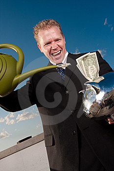 Watering Investment Royalty Free Stock Photo - Image: 9430815