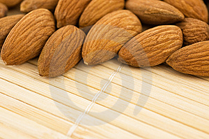 Group Of Almonds On A Bamboo Mat. Royalty Free Stock Photography - Image: 9438977