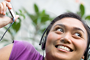 Young Woman And Mp3 Player Stock Image - Image: 9439811