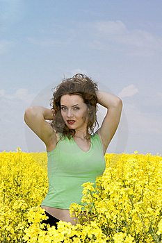 Seductive Young Woman In Rape Flower Field Stock Photo - Image: 9442160
