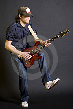 Guitarist Playing His Guitar With One Leg Up Stock Photography - Image: 9450162