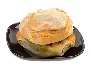 Bread Loaf Stacked On A Black Plate On White Stock Photography - Image: 9474462
