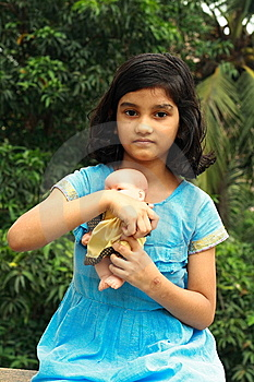 Girl With Her Doll Royalty Free Stock Photography - Image: 9499847
