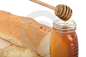 Honey and baguette Stock Photos