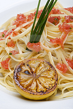 Plate Of Linguine Topped With Diced Tomatos Stock Images - Image: 9502544