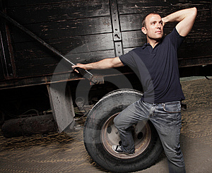 Man Posing By A Truck Stock Image - Image: 9512061