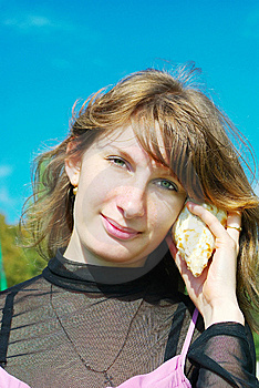 Girl Hears The Sounds Of Sea Stock Photos - Image: 9519523