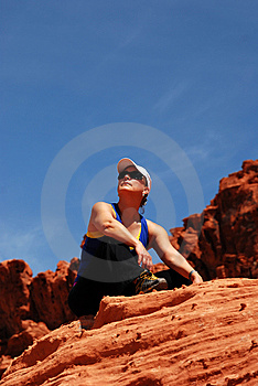 Athletic Woman Sitting On Rock Royalty Free Stock Photography - Image: 9528257