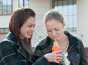 One Girl Give To Drink To Other Stock Photos - Image: 9535023
