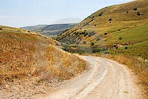 Countryside Road Bends Among Yellow Hills Royalty Free Stock Photography - Image: 9539107