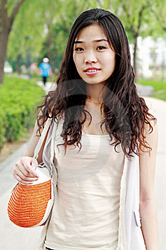 Asian Girl Outdoors. Royalty Free Stock Images - Image: 9544559