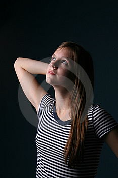 Petty Teen With Arm Raised As If Stretching Royalty Free Stock Photography - Image: 9556477