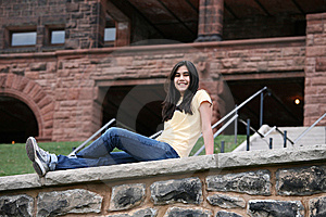Teen Girl Sitting On Rock Ledge Stock Photo - Image: 9573320