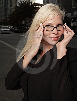 Businesswoman Adjusting Her Glasses Stock Photos - Image: 9578023