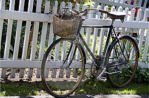 Old Rusty Bike Leaned To The White Fence Royalty Free Stock Image - Image: 9587356