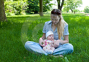 Baby In Mother's Lap Outdoors Royalty Free Stock Photo - Image: 9595075