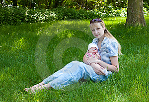Baby And Mother Sitting In The Grass Stock Photos - Image: 9599353