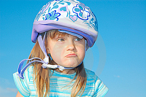 Grimacing Girl With A Helmet Royalty Free Stock Images - Image: 9611109