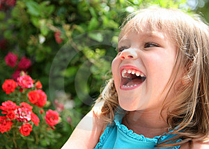 Laughing Little Girl Near Red Flowers Stock Images - Image: 9613844