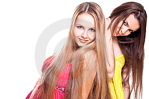 Two Beautiful Women In A Colored Dress Royalty Free Stock Photography - Image: 9618507