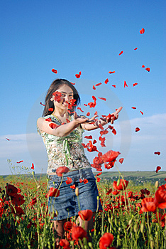 Girl on a red poppies field