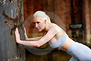 Fit Athletic Woman Stretching Against A Wall Royalty Free Stock Image - Image: 9622976