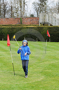 Girl Playing Mini Golf Stock Photo - Image: 9623090