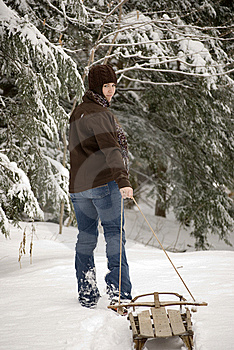 Beautiful Woman Pulling Sled Through Snow Stock Photo - Image: 9628270