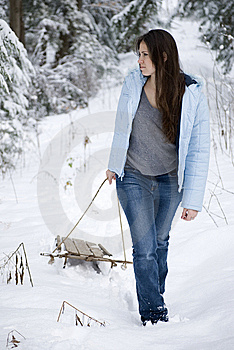 Beautiful Woman Pulling Sled Royalty Free Stock Photos - Image: 9628428