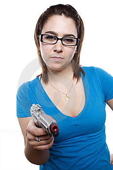 Young Girl With Attitude And Holding Gun Royalty Free Stock Photo - Image: 9631345