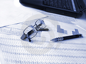 Laptop, Glasses And Pen On Financial Documents. Royalty Free Stock Photos - Image: 9635258