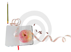 Diary With Apple And Pills For Effective Dieting Stock Image - Image: 9635801