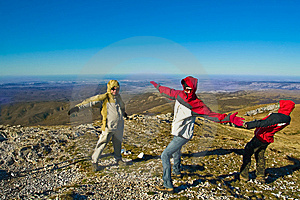 Happy Hikers In Mountains Playing With Strong Wind Stock Images - Image: 9635834