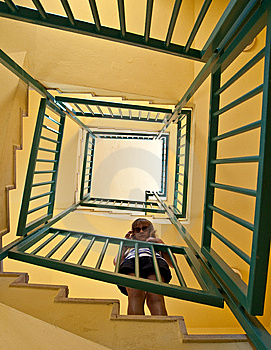 Girl Stands On The Spiral Staircase Stock Photo - Image: 9639560