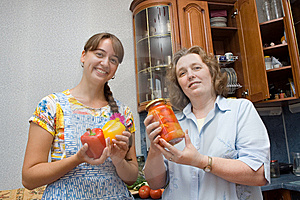 Girl And Grandma Holding Pepper And Jam Stock Photos - Image: 9663873