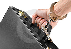 Hand On Handcuffs With A Briefcase Stock Photo - Image: 9667460