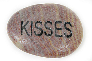 Kisses Engraved On Stone Royalty Free Stock Images - Image: 9669759