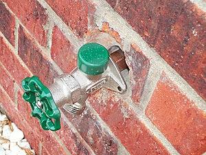 Water Spigot Outside Green Brick Building Stock Photos - Image: 9679373