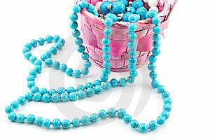 Colored Pearl Beads In Pink Wicker Basket Isolated Stock Images - Image: 9682994