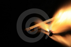 Match Bursting Into Flames Stock Photo - Image: 9683460